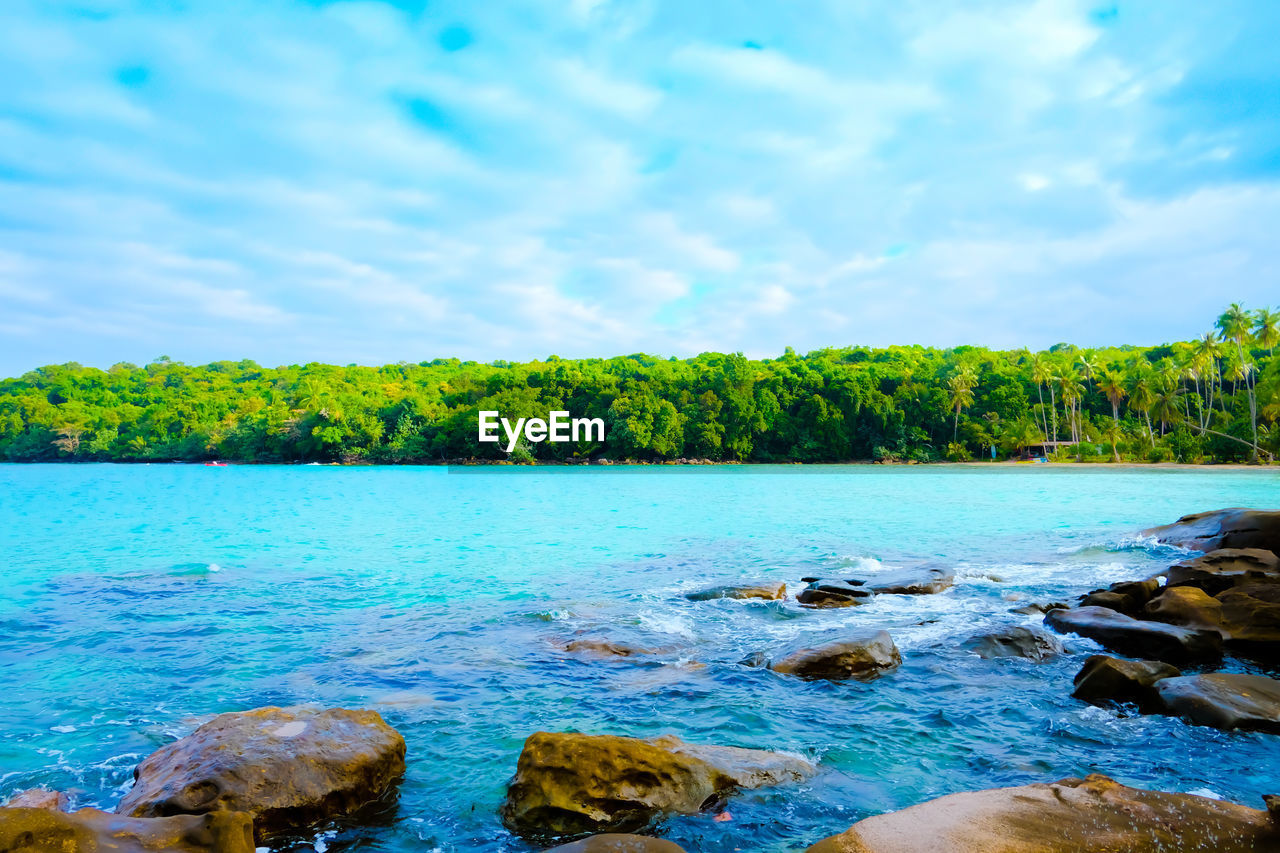 water, beauty in nature, sky, scenics - nature, plant, tranquility, tree, cloud - sky, nature, tranquil scene, day, no people, green color, land, rock, idyllic, lake, rock - object, non-urban scene, outdoors, turquoise colored, flowing water