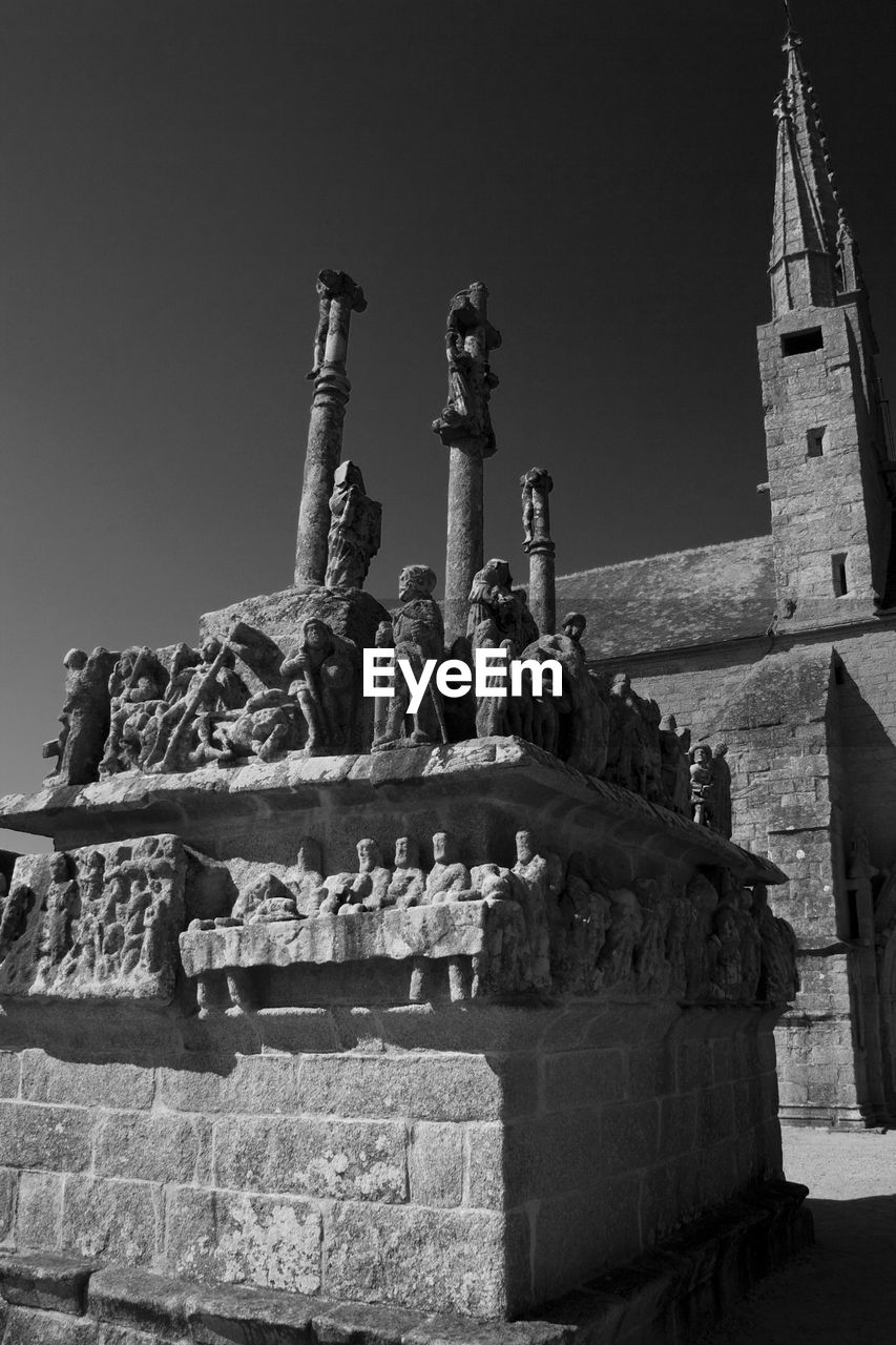 history, religion, low angle view, sculpture, spirituality, statue, built structure, outdoors, architecture, travel destinations, no people, place of worship, ancient, day, clear sky, sky, ancient civilization, building exterior
