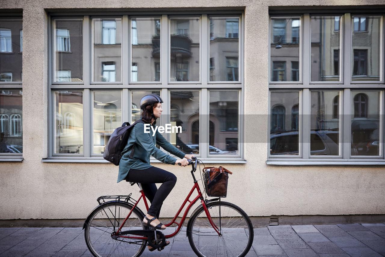 MAN RIDING BICYCLE ON WINDOW