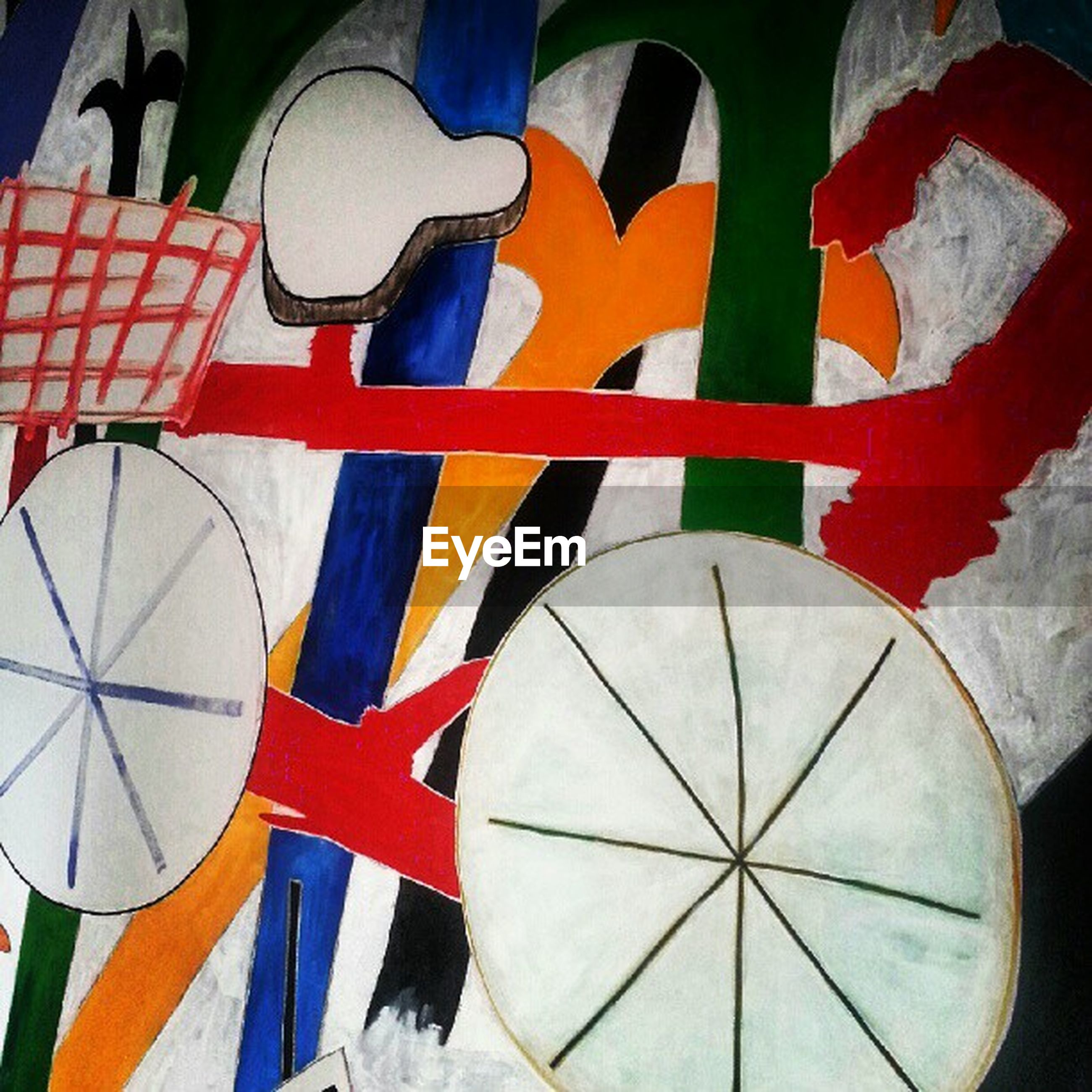 multi colored, low angle view, pattern, art and craft, design, art, creativity, indoors, hanging, shape, red, decoration, colorful, no people, built structure, geometric shape, architecture, close-up, umbrella, day