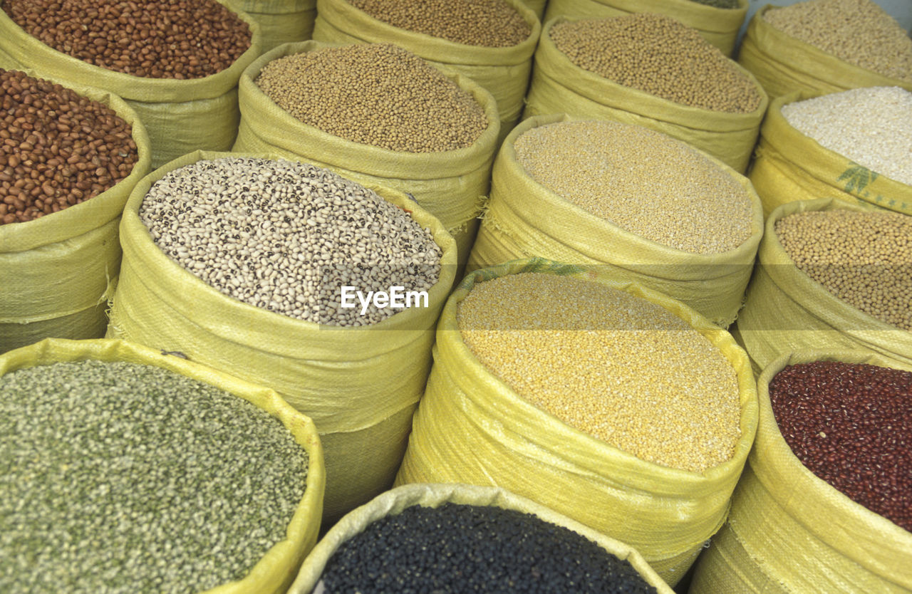 High angle view of legumes in sacks at market