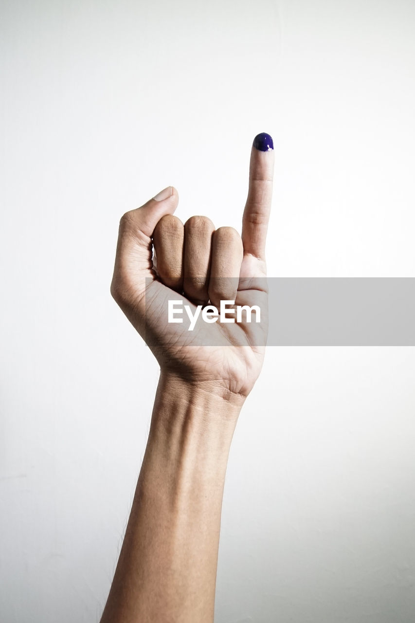 human hand, hand, human body part, studio shot, body part, indoors, white background, gesturing, one person, finger, human finger, hand sign, unrecognizable person, showing, copy space, communication, close-up, personal perspective, success, human limb, aggression, stop gesture
