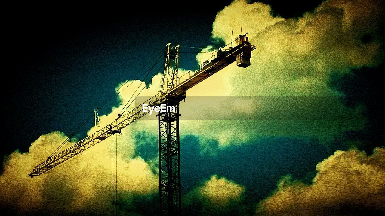 sky, architecture, crane - construction machinery, construction site, built structure, silhouette, outdoors, crane, no people, low angle view, industry, building exterior, illuminated, night, nature, tree