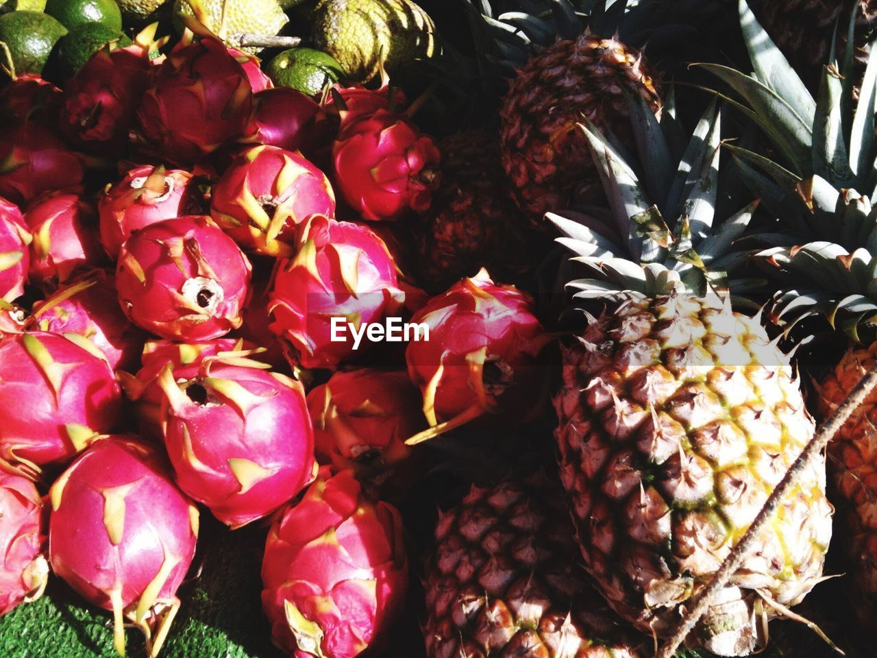Pitayas And Pineapples For Sale At Market Stall