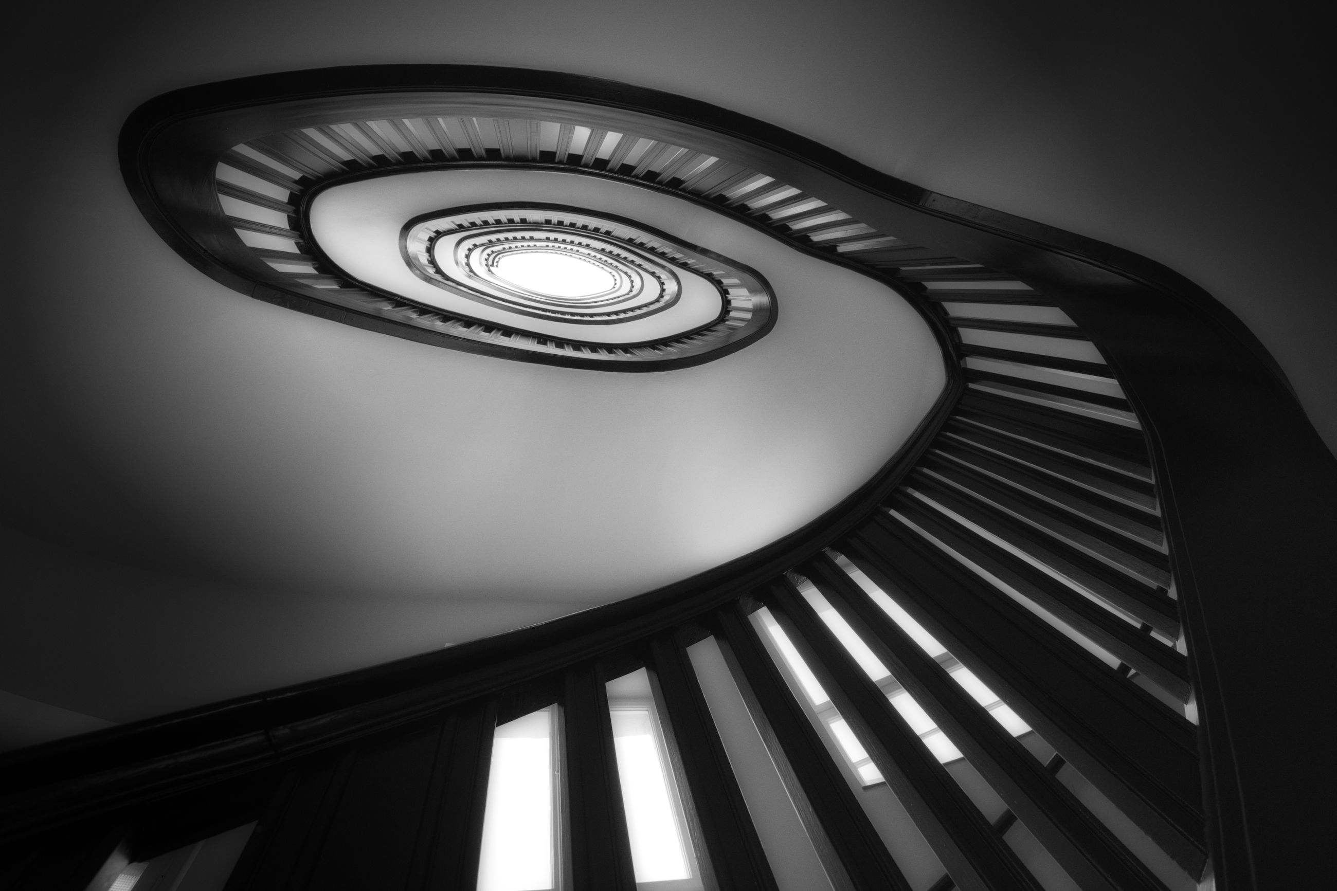 LOW ANGLE VIEW OF SPIRAL STAIRCASE ON BUILDING