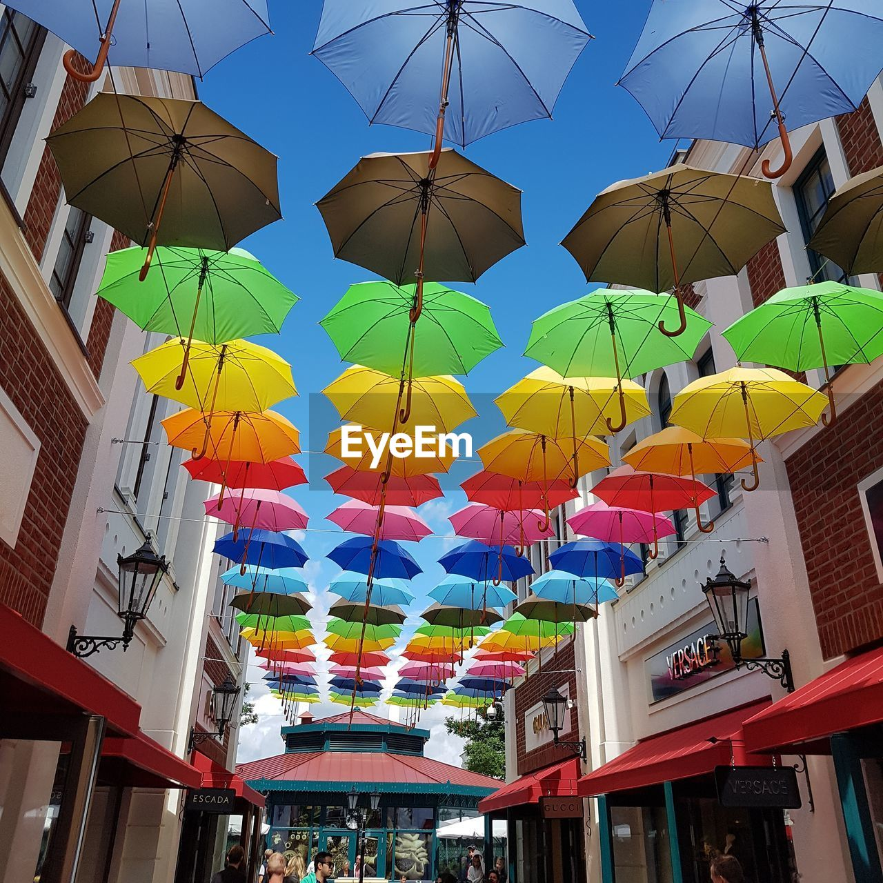 Day Hanging Multi Colored Low Angle View Celebration Lantern Outdoors No People Architecture Umbrella Umbrellas In The Sky Umbrellas Regenschirme Shopping ♡ Blue Sky Blue Sky Sky And Colors Clear Sky