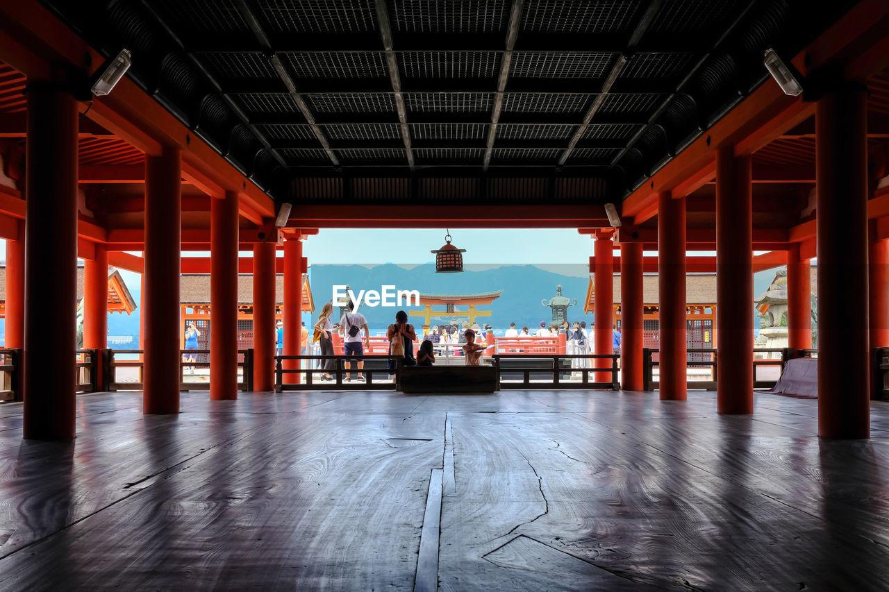 People Praying At Itsukushima Shrine