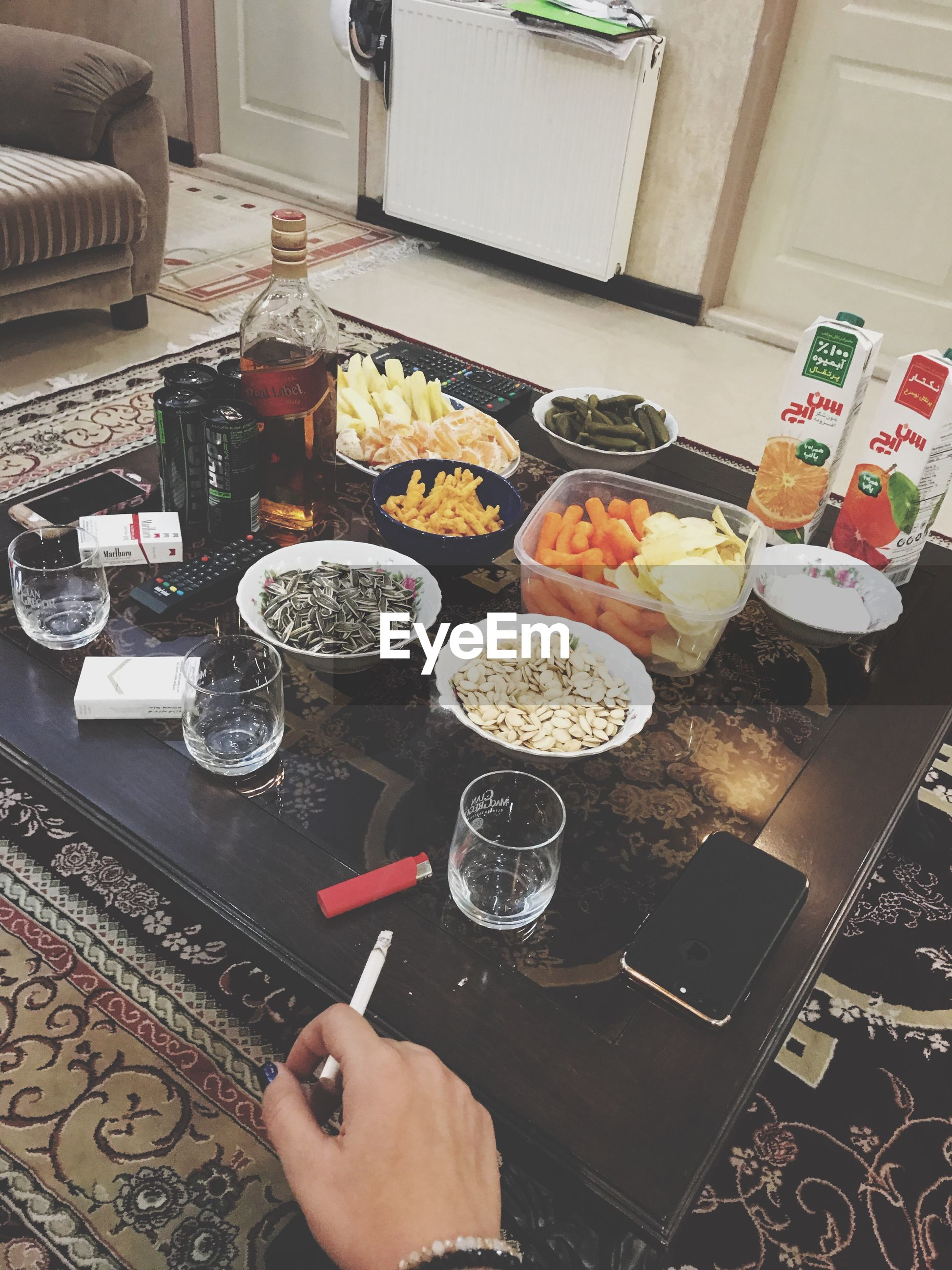 food and drink, food, human hand, indoors, freshness, human body part, one person, healthy eating, high angle view, holding, real people, fruit, ready-to-eat, drink, day, people