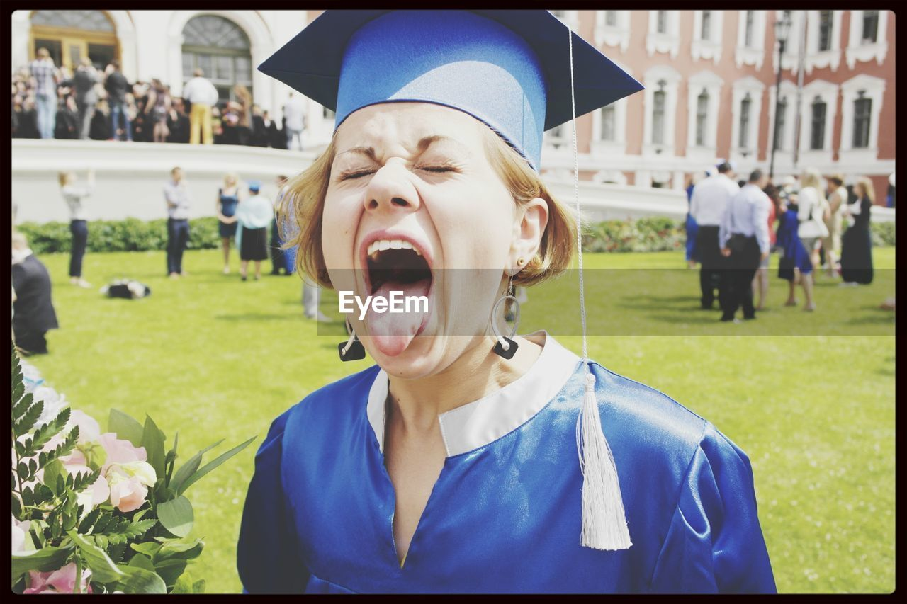 Female Graduate Sticking Out Tongue