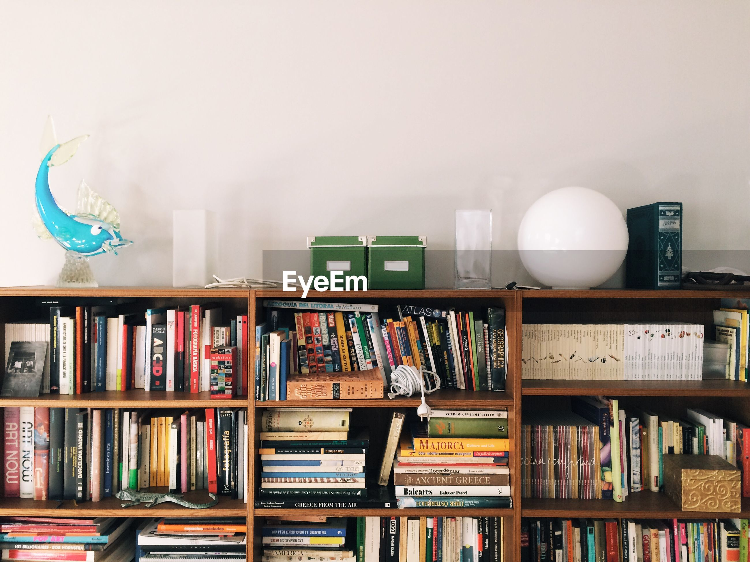 STACK OF OBJECTS IN SHELF