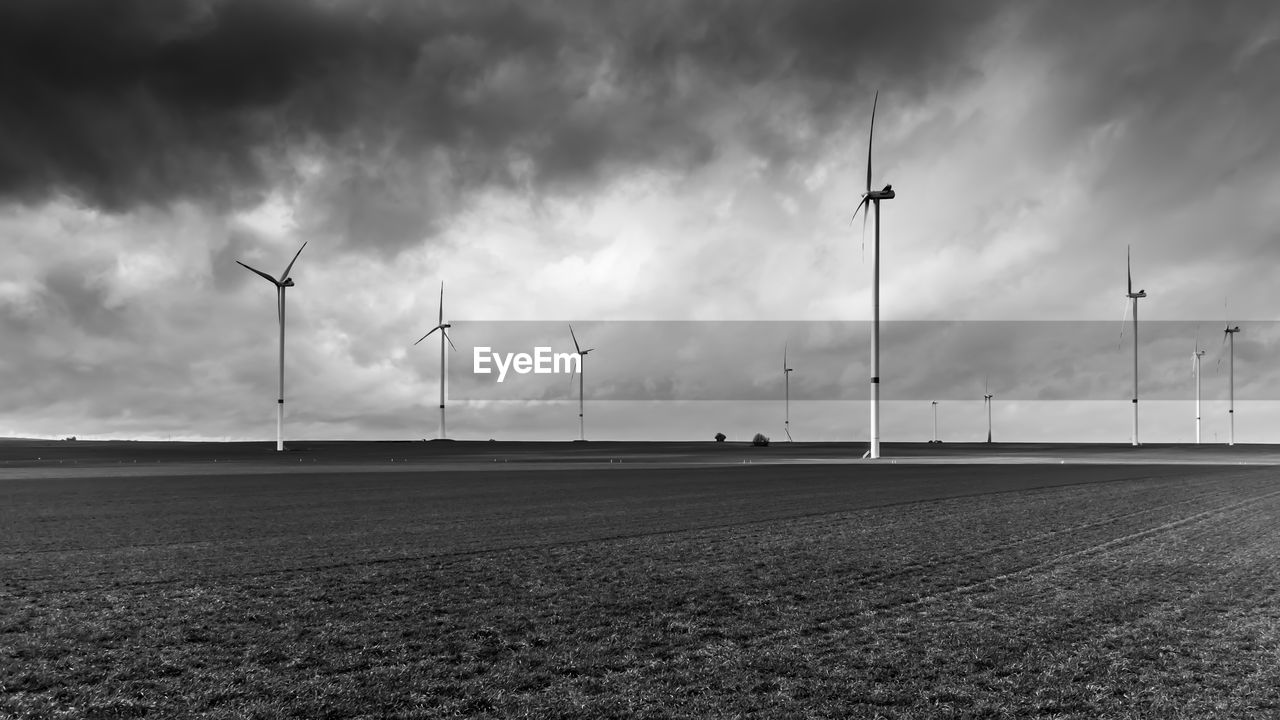 sky, wind turbine, environment, turbine, cloud - sky, alternative energy, field, renewable energy, wind power, environmental conservation, land, fuel and power generation, landscape, nature, no people, rural scene, technology, outdoors, scenics - nature, sustainable resources