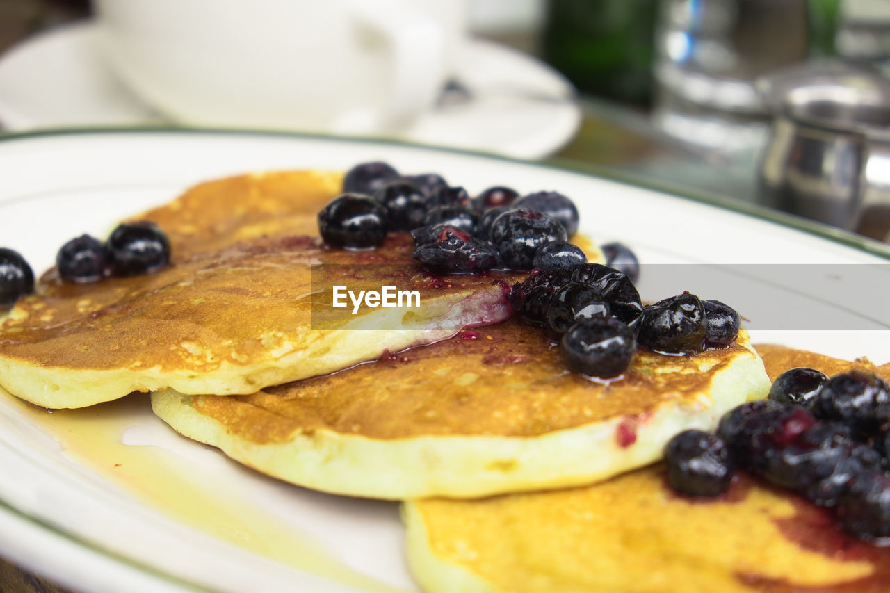 Close-up of pancakes in plate on table
