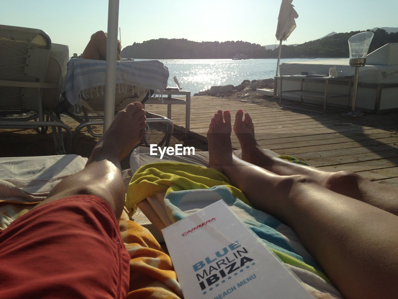 low section, human leg, human foot, barefoot, human body part, real people, two people, day, leisure activity, sunlight, relaxation, water, togetherness, vacations, sea, sitting, men, women, outdoors, nautical vessel, human hand, people