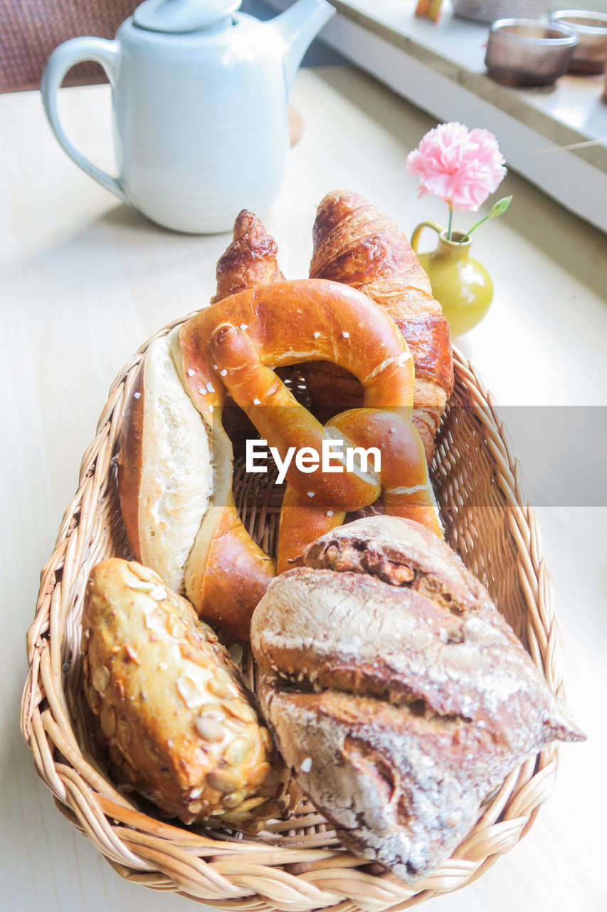 food and drink, food, basket, freshness, container, bread, still life, baked, table, ready-to-eat, close-up, wicker, no people, high angle view, healthy eating, indoors, focus on foreground, bun, cup, wellbeing, french food, snack, breakfast