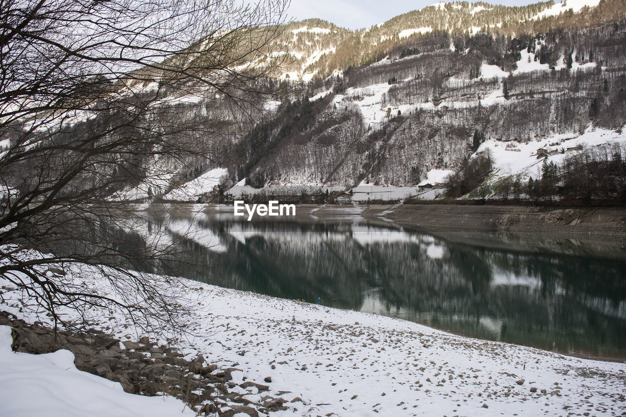 cold temperature, snow, winter, tree, plant, tranquil scene, tranquility, water, beauty in nature, scenics - nature, nature, mountain, lake, day, no people, non-urban scene, environment, reflection, outdoors, snowcapped mountain