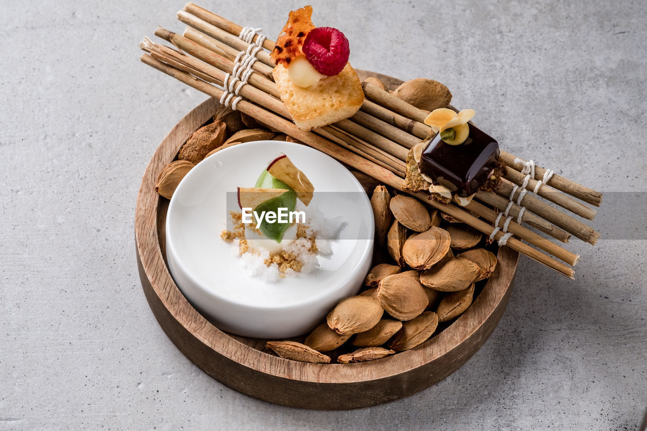 food, food and drink, freshness, table, ready-to-eat, still life, nut, high angle view, fruit, no people, healthy eating, nut - food, indoors, wellbeing, cinnamon, plate, close-up, wood - material, spice, sweet food, snack, temptation