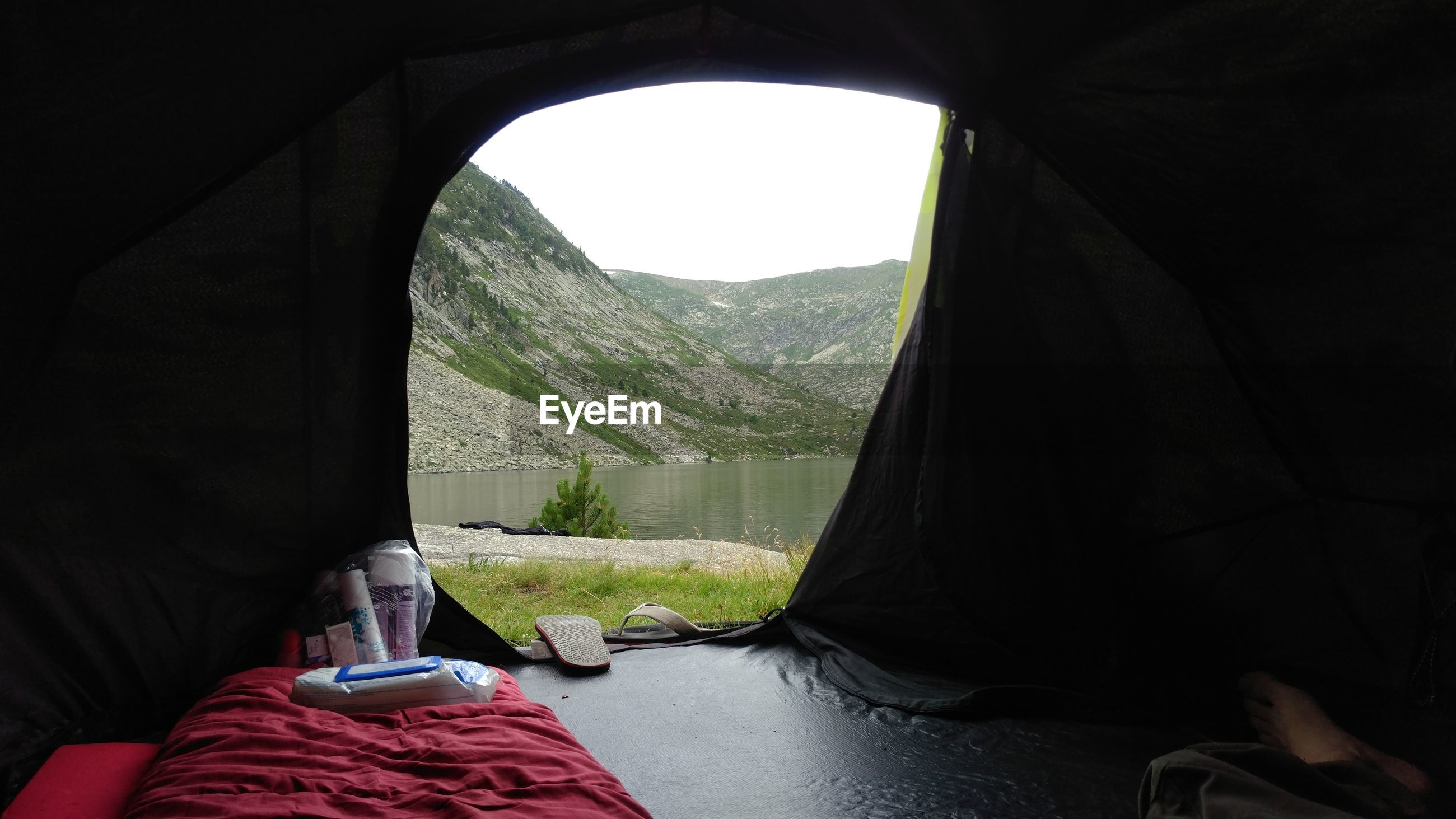 Scenic view of mountains seen through tent