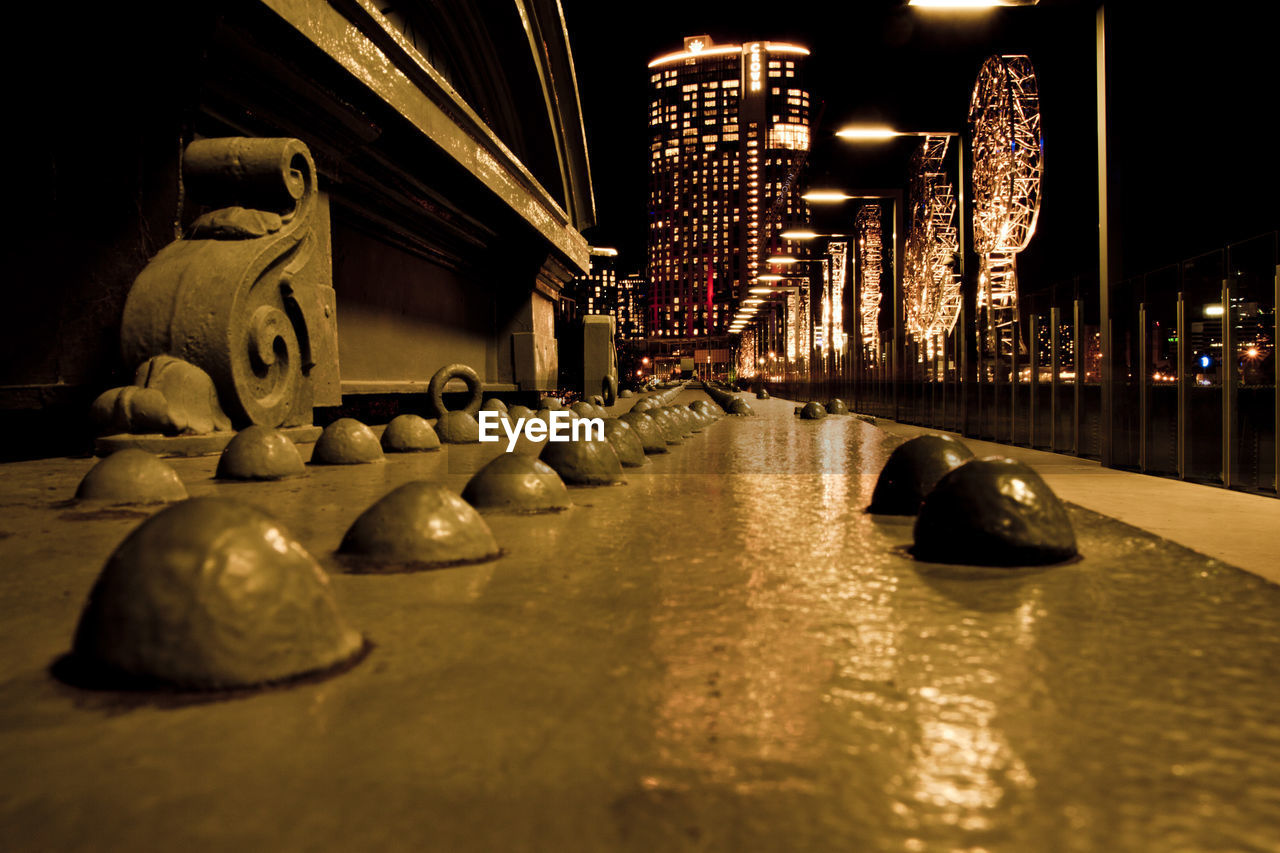illuminated, built structure, architecture, night, building exterior, no people, city, building, bridge, reflection, selective focus, art and craft, bridge - man made structure, in a row, water, lighting equipment, connection, surface level, nature, nightlife