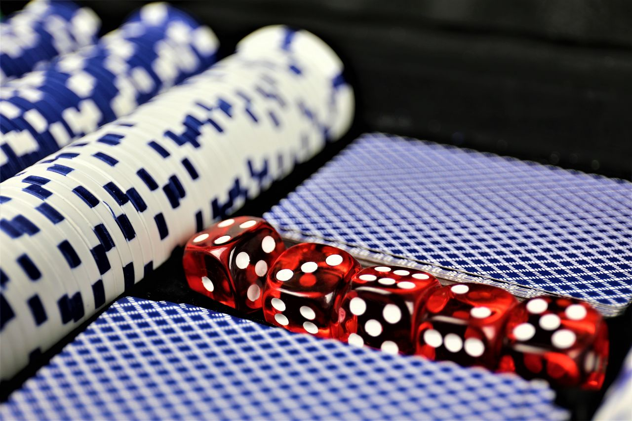 Close-Up Of Dice And Gambling Chips On Table