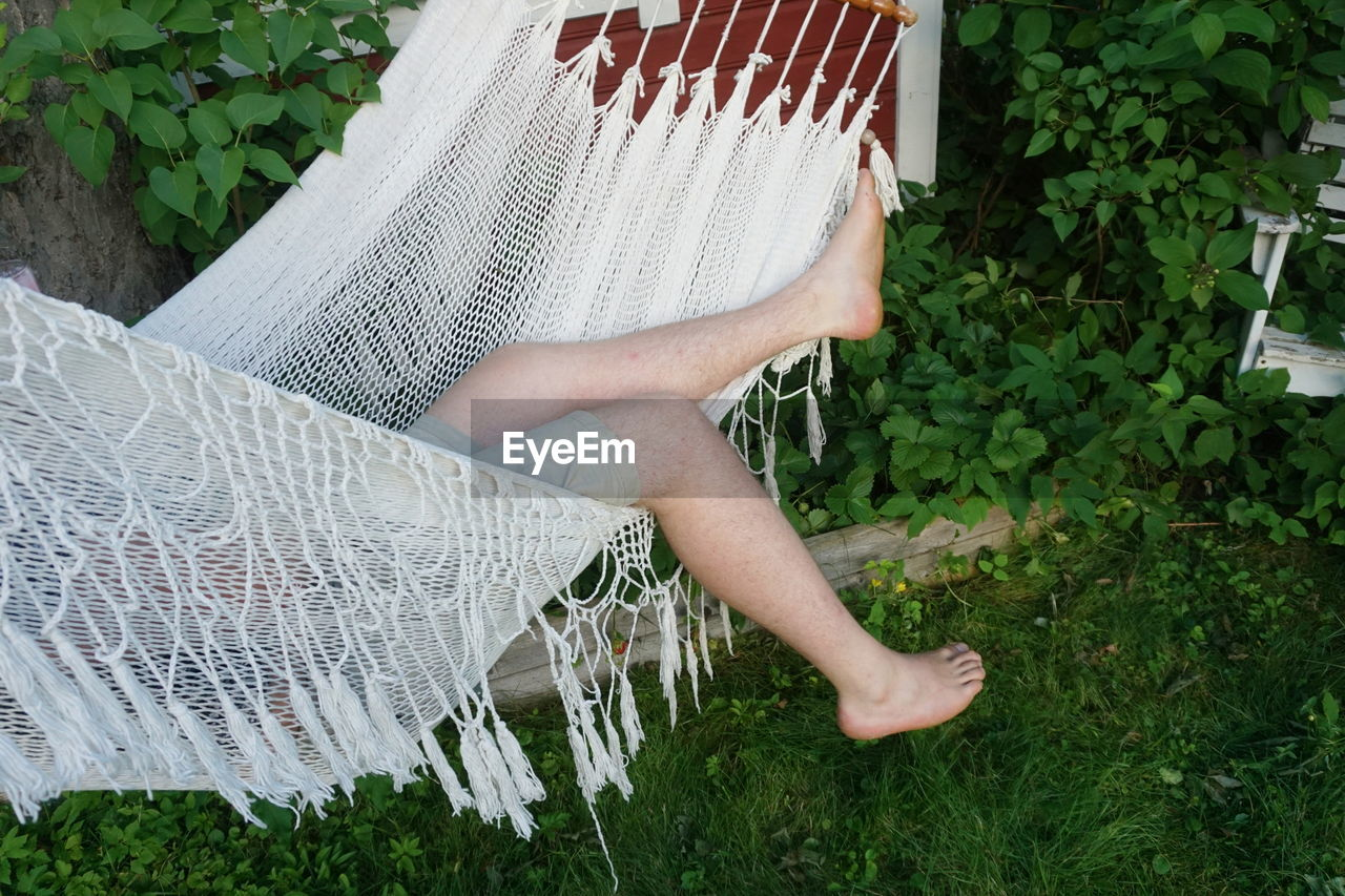 Low Section Of Man Sleeping In Hammock