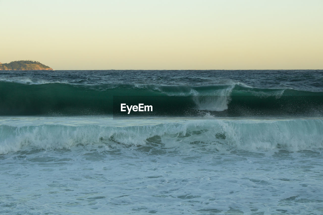 water, sea, motion, horizon over water, horizon, scenics - nature, sky, beauty in nature, wave, sport, clear sky, waterfront, aquatic sport, surfing, nature, beach, land, power in nature, outdoors, flowing water