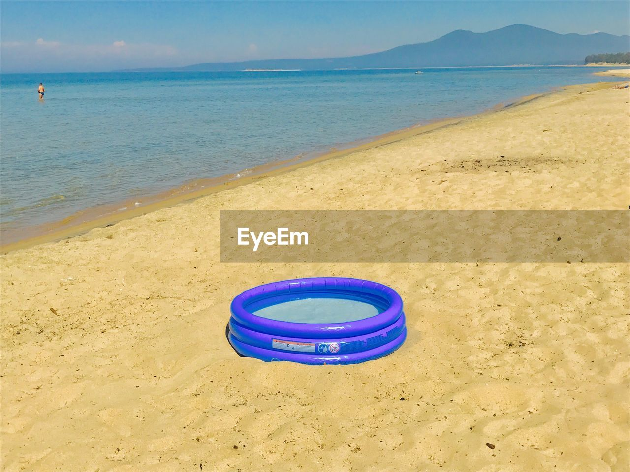sand, beach, water, circle, day, sea, outdoors, no people, tranquility, nature, blue, scenics, beauty in nature, sky, horizon over water