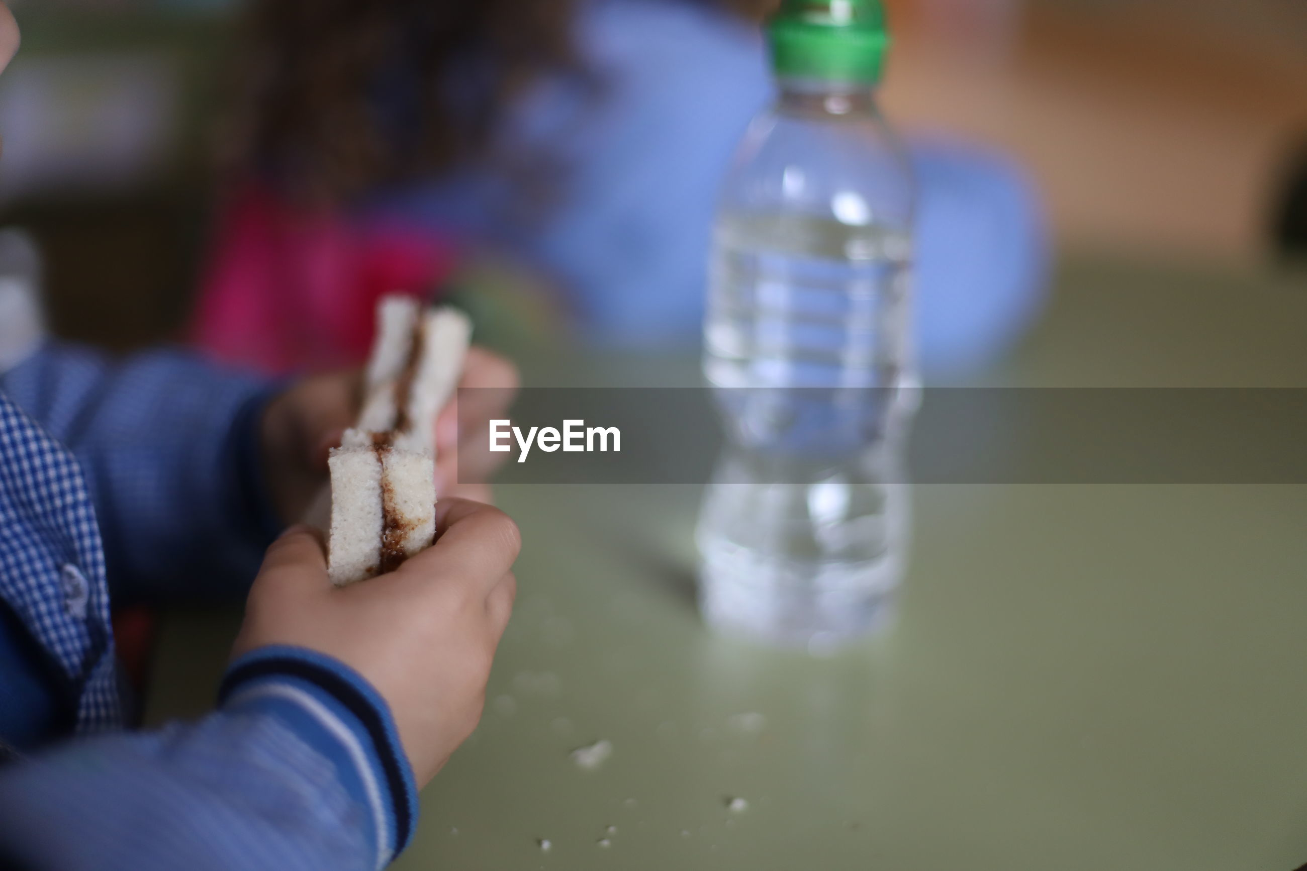 Close-up of child hand holding lunch