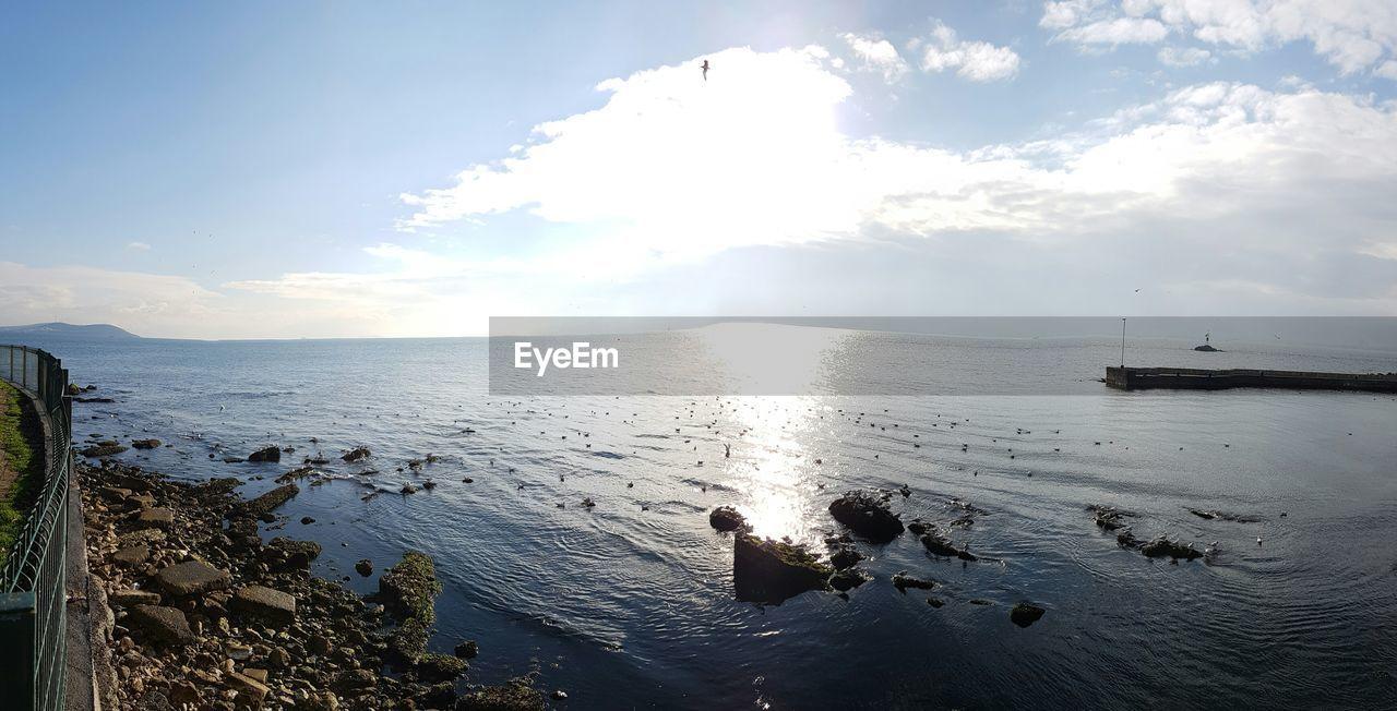 water, sky, cloud - sky, sea, scenics - nature, beauty in nature, nature, tranquil scene, tranquility, day, no people, land, non-urban scene, beach, sunlight, reflection, outdoors, horizon, idyllic, horizon over water