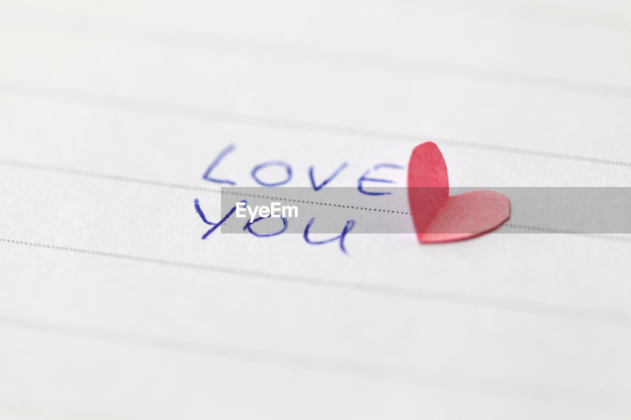 close-up, no people, paper, heart shape, communication, indoors, selective focus, red, positive emotion, love, text, western script, emotion, studio shot, still life, copy space, creativity, document, letter, pulse trace, valentine's day - holiday, love letter, message