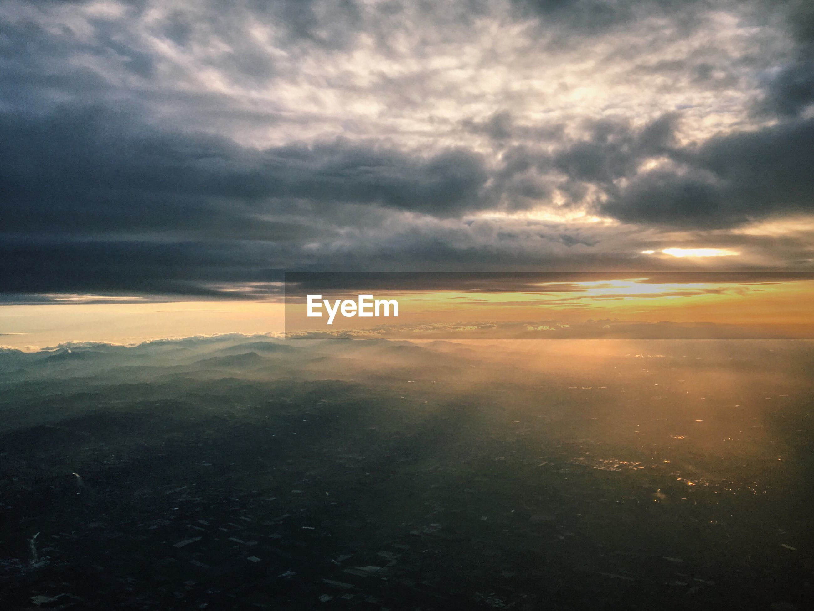 AERIAL VIEW OF CLOUDY SKY OVER MOUNTAINS