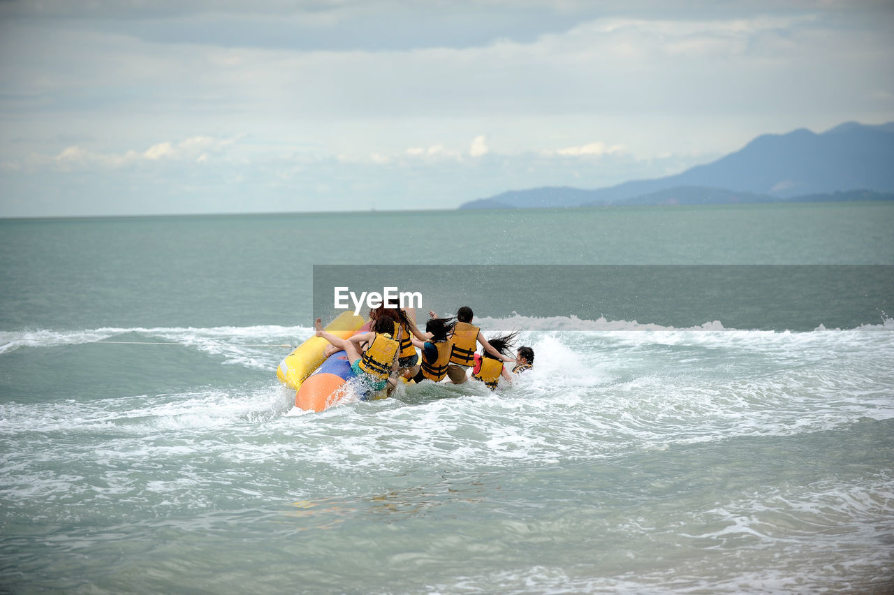 People Kayaking In Sea