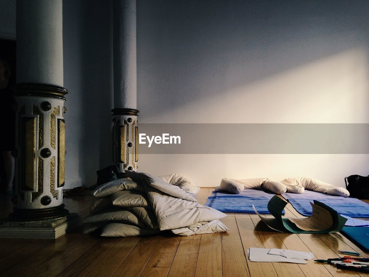 Stack On Pillows On Hardwood Floor At Home