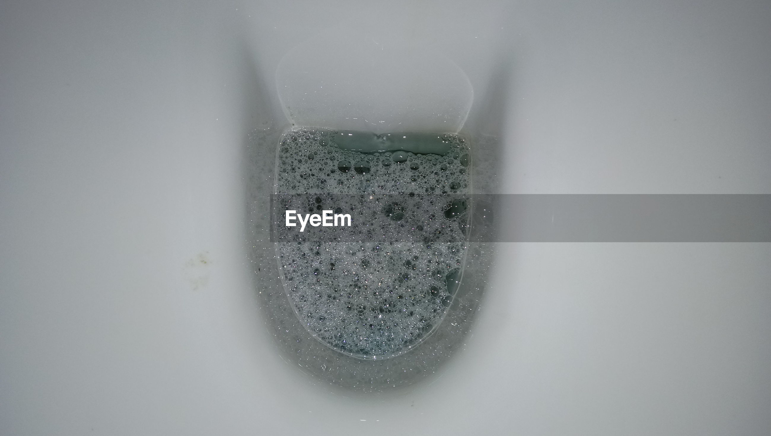 Directly above shot of bubbles in toilet bowl