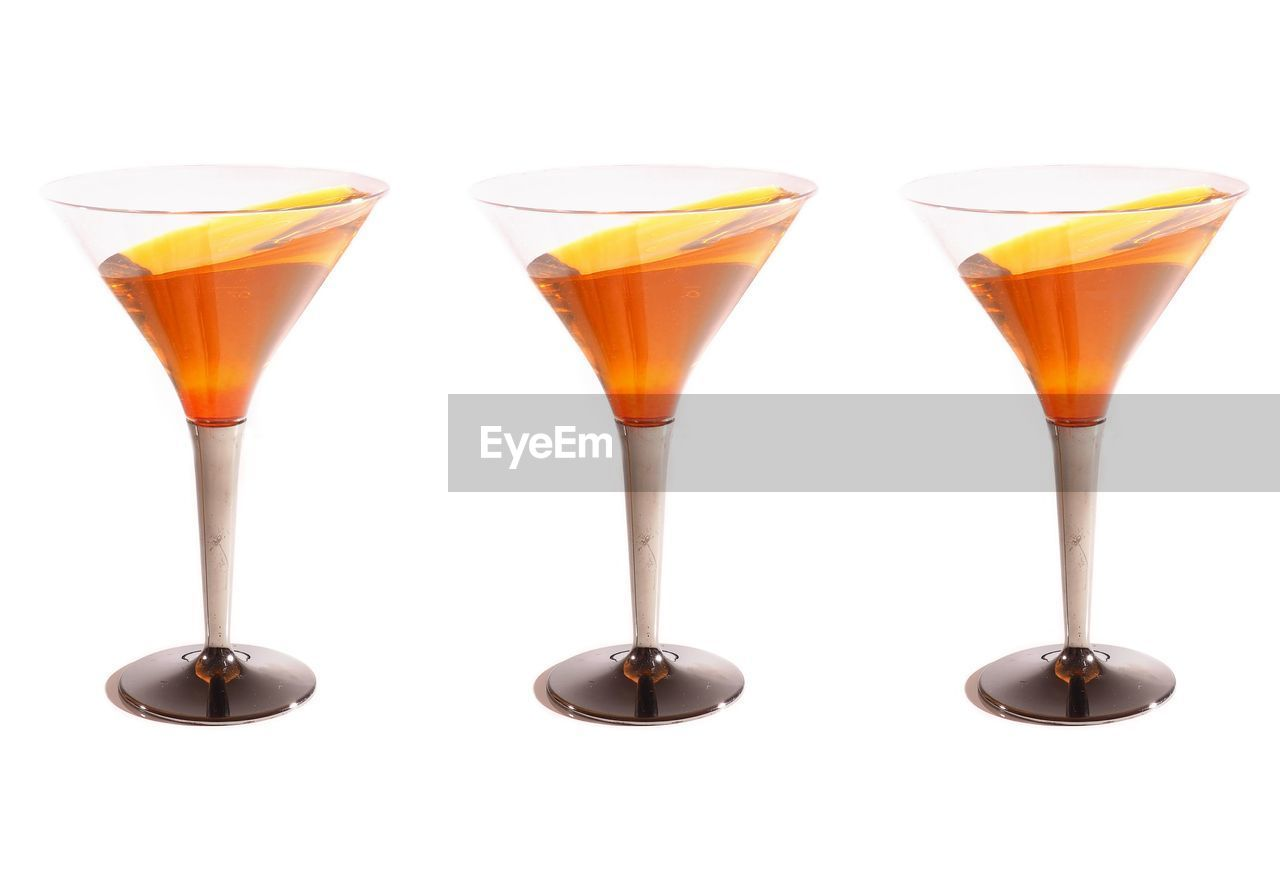 white background, drink, still life, cocktail, refreshment, food and drink, no people, studio shot, alcohol, close-up, freshness, multi colored, liqueur, day