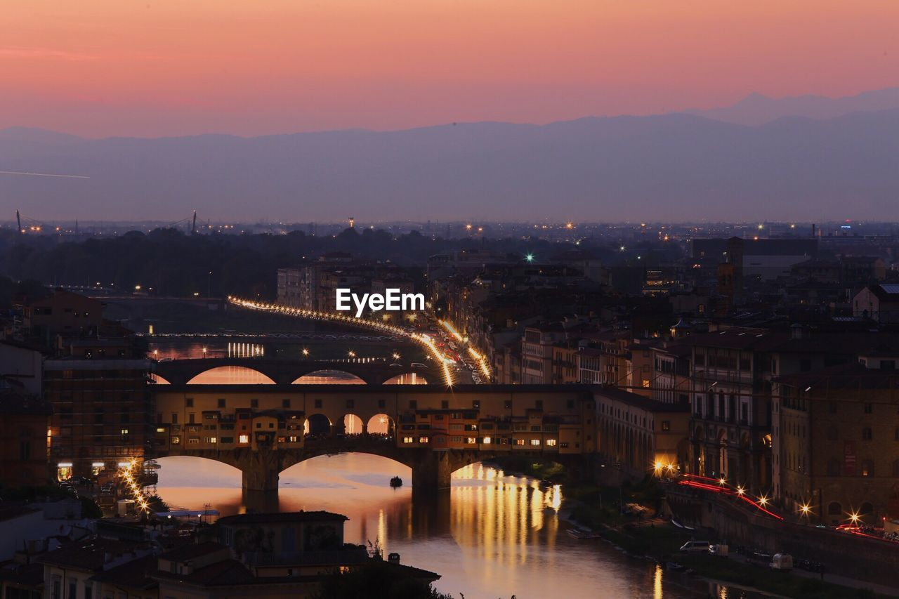 Ponte Vecchio Over Arno River Against Sky During Sunset