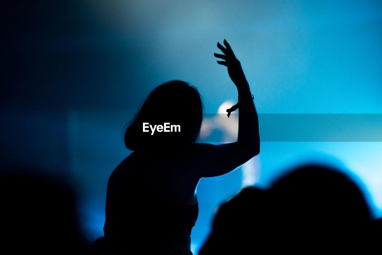 Silhouette people enjoying at music concert