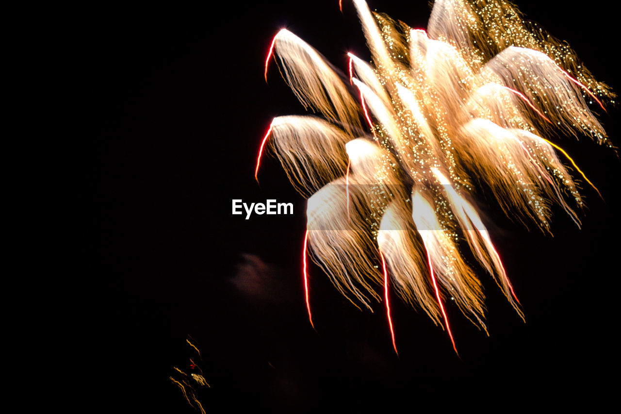 night, illuminated, firework display, celebration, long exposure, firework - man made object, low angle view, no people, motion, outdoors, sky, close-up