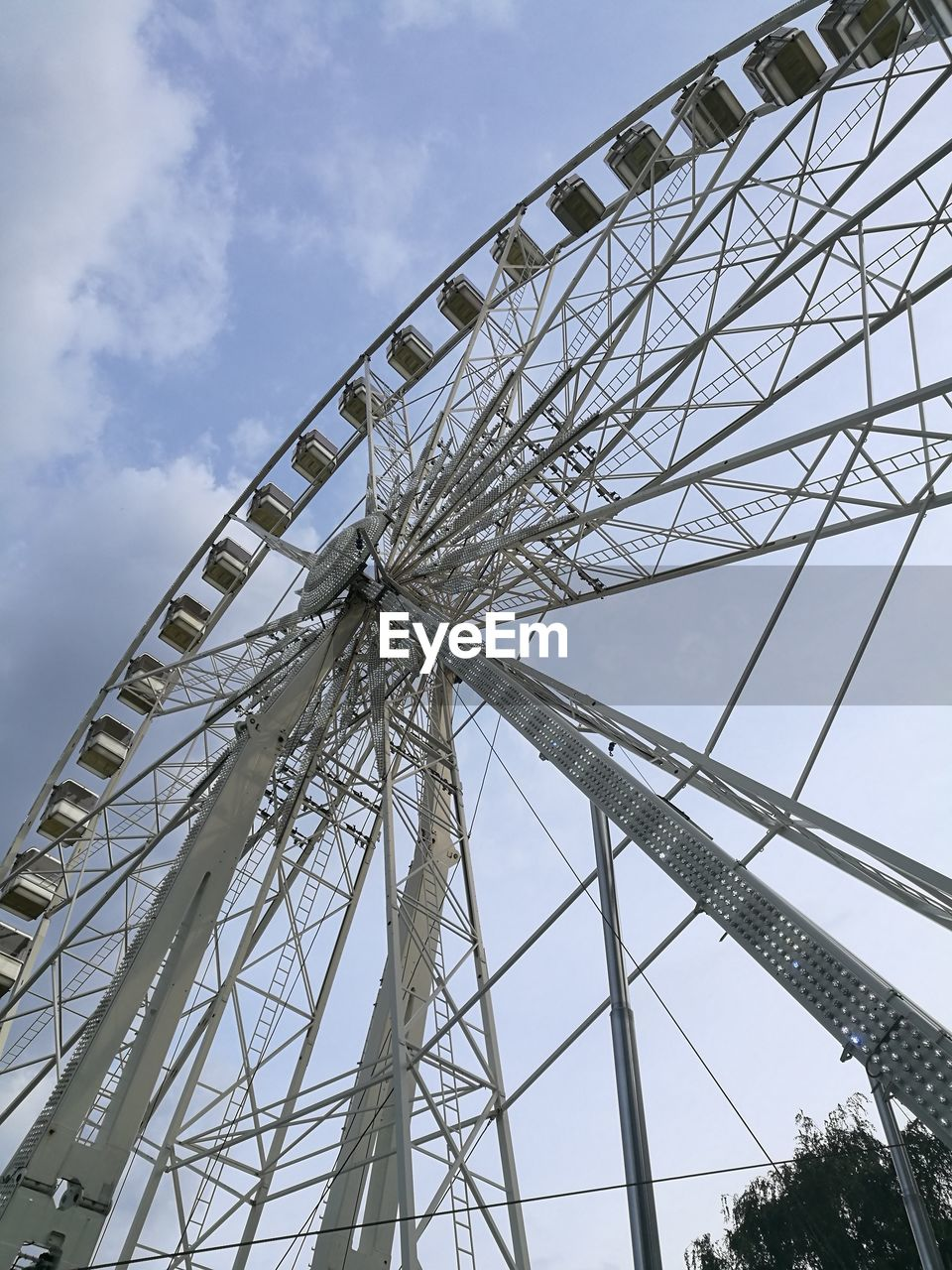 amusement park, arts culture and entertainment, low angle view, ferris wheel, amusement park ride, day, sky, big wheel, no people, outdoors