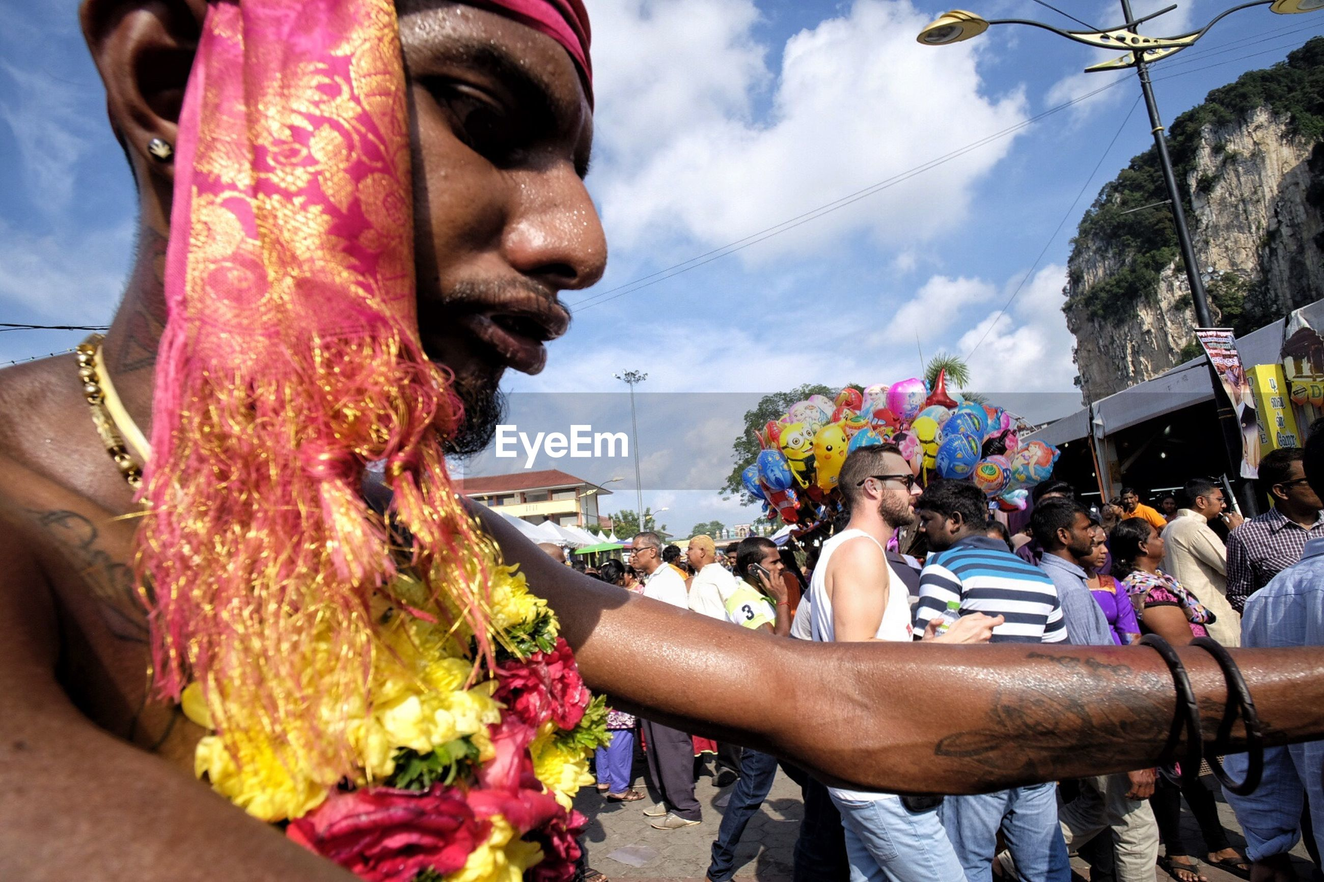 real people, men, outdoors, celebration, day, lifestyles, leisure activity, large group of people, traditional festival, event, sky, flower, women, multi colored, ceremony, crowd, food, holi, people