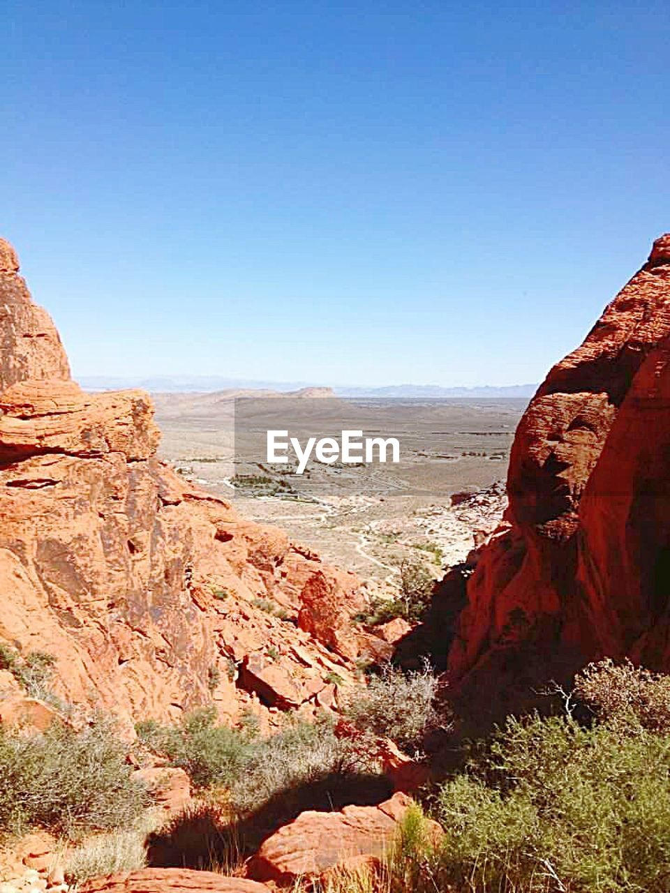 rock - object, rock formation, scenics, travel destinations, nature, canyon, geology, sunlight, landscape, beauty in nature, outdoors, desert, day, tranquil scene, tranquility, travel, arid climate, red, physical geography, clear sky, no people, mountain, sky, rock hoodoo