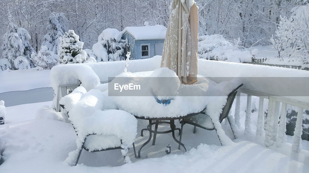 Frozen chairs and table in restaurant