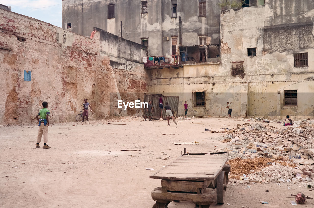 Friends playing against abandoned buildings