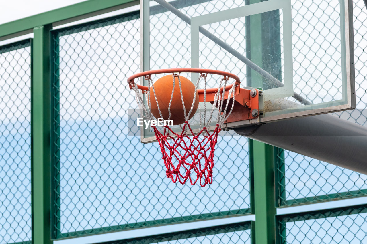 Low angle view of ball in basketball hoop