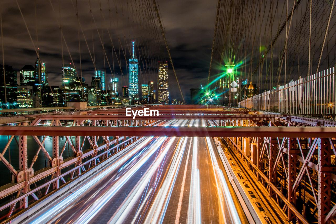 Light Trails On Brooklyn Bridge Against Sky At Night