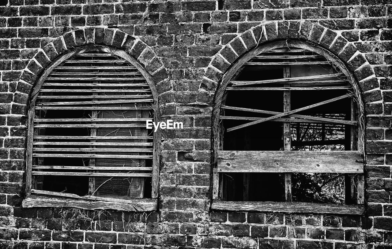 architecture, built structure, old, no people, abandoned, damaged, day, window, arch, wall, building exterior, wall - building feature, history, run-down, weathered, the past, metal, building, obsolete, deterioration, outdoors, brick, stone wall, wheel