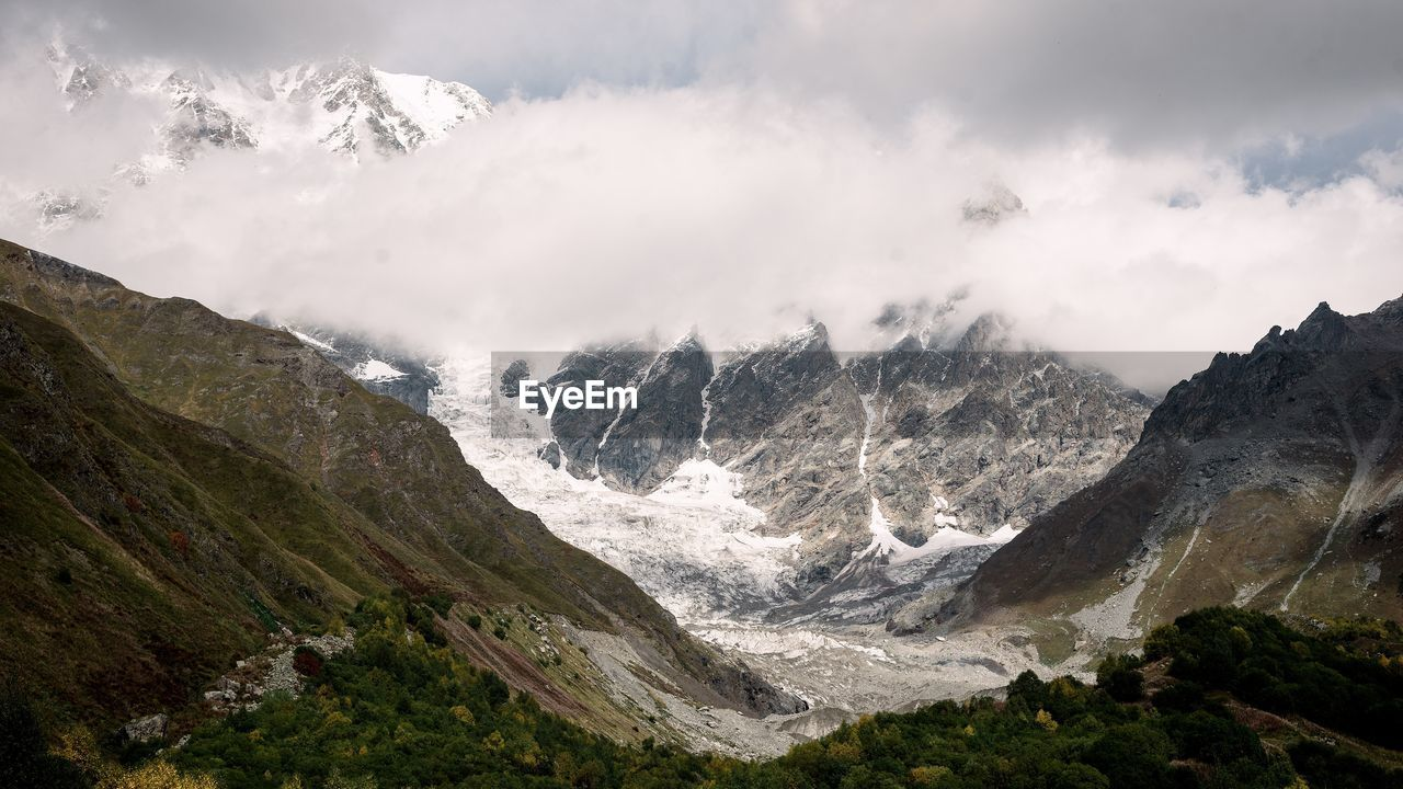 mountain, beauty in nature, scenics - nature, environment, nature, sky, landscape, no people, mountain range, non-urban scene, tranquil scene, rock, tranquility, day, snow, cloud - sky, water, cold temperature, outdoors, mountain peak, flowing water, formation, snowcapped mountain