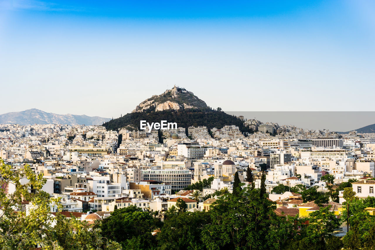 View Of Cityscape With Mountain In Background
