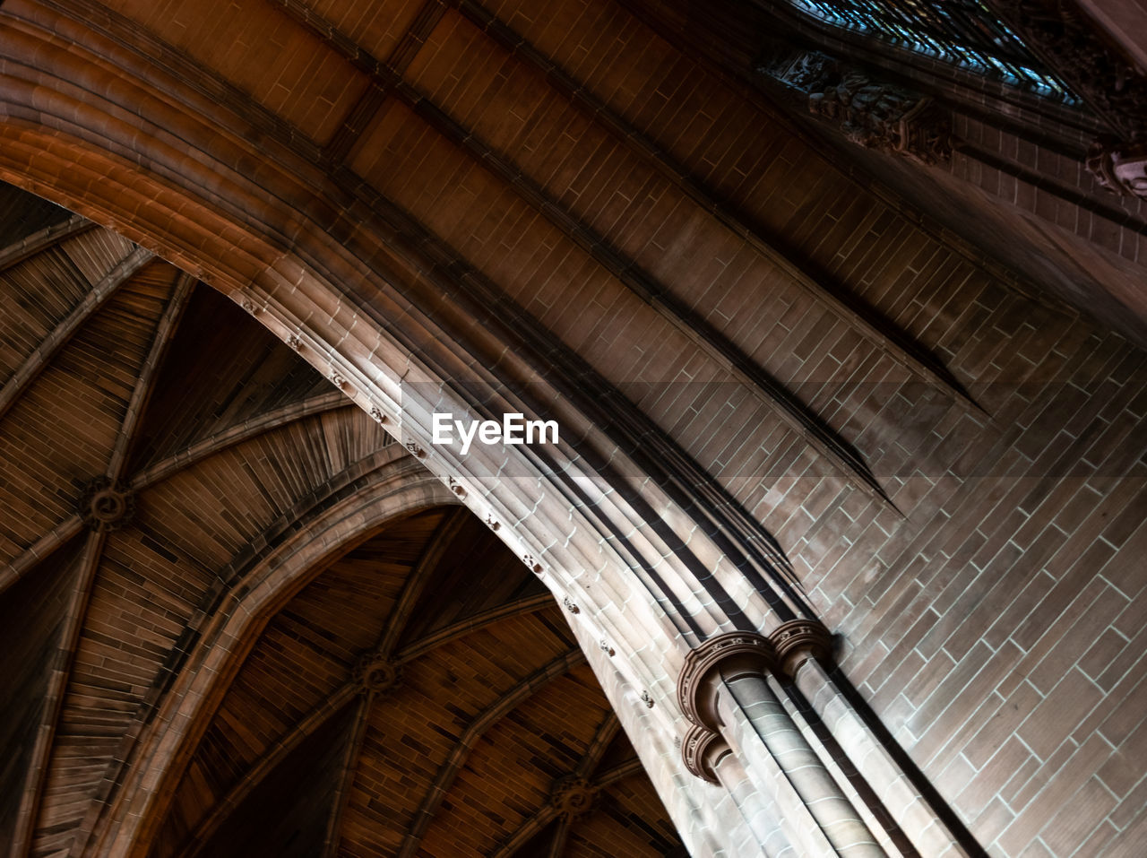 built structure, architecture, low angle view, the past, history, no people, ceiling, indoors, architectural column, place of worship, building, arch, religion, belief, spirituality, travel destinations, architectural feature, directly below, roof beam