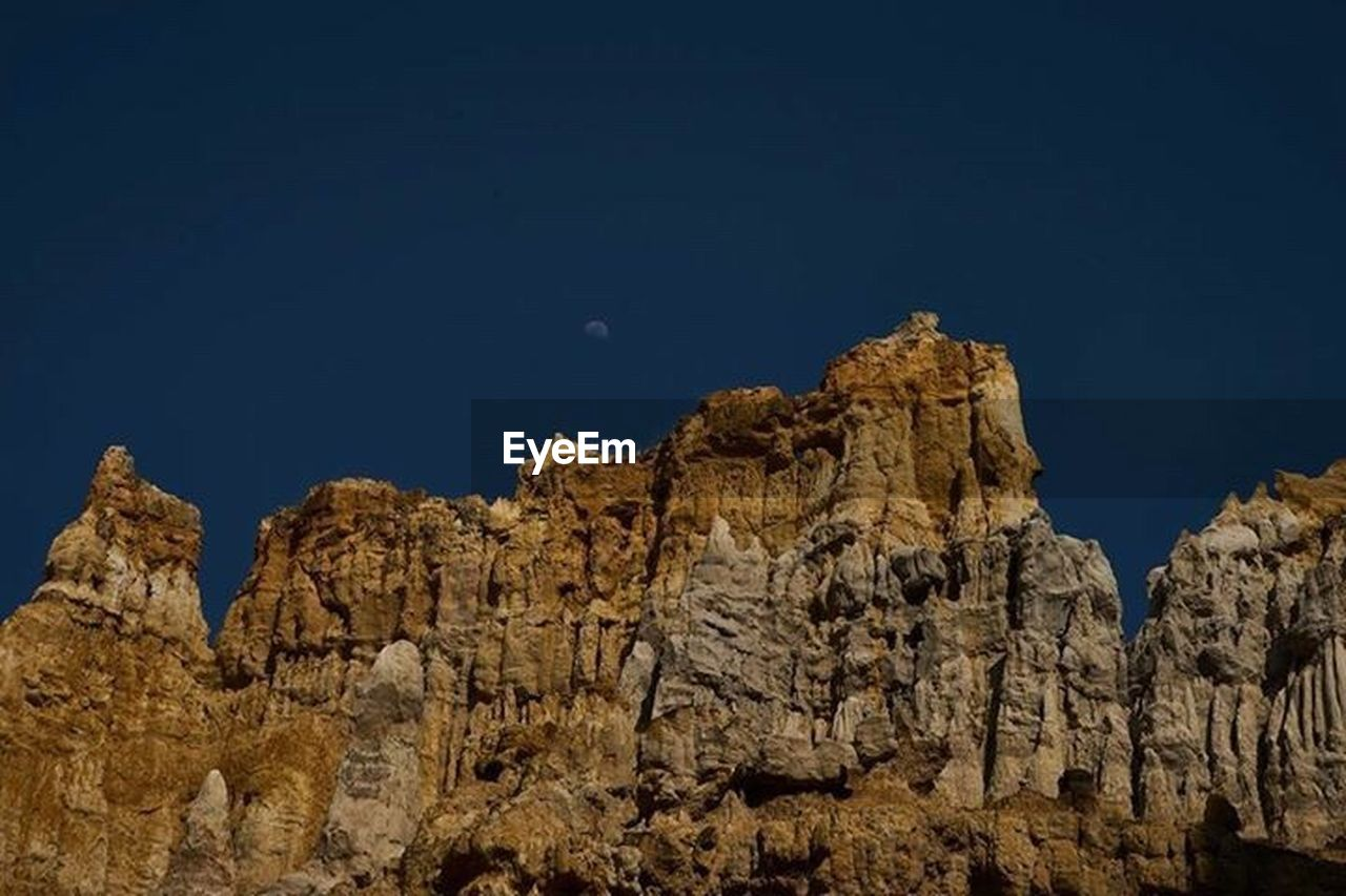 rock, rock - object, rock formation, solid, scenics - nature, sky, nature, no people, physical geography, land, mountain, blue, geology, beauty in nature, mountain range, clear sky, non-urban scene, low angle view, tranquil scene, tranquility, outdoors, eroded, formation, arid climate, climate, mountain peak