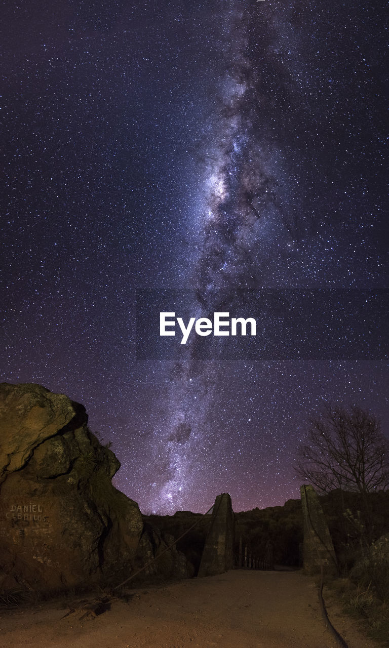 astronomy, star - space, night, space, sky, galaxy, beauty in nature, scenics - nature, nature, no people, rock formation, milky way, star, rock, rock - object, tranquility, star field, solid, land, tranquil scene, outdoors